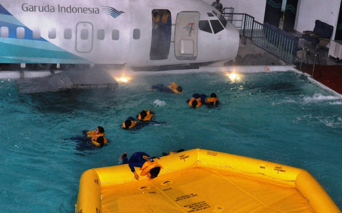 A safety drill being performed in a flight attendant training session at Garuda Indonesia. Photo credit: US Embassy, Jakarta.