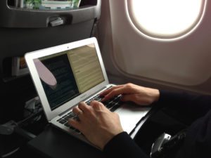 A man travelling with his rugged computer